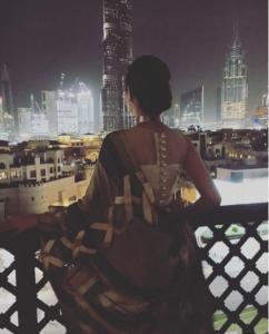 1. Mahira Khan enjoying a stunning view of the Dubai skyline