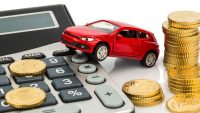 car and calculator. rising costs for buying a car, leasing, work