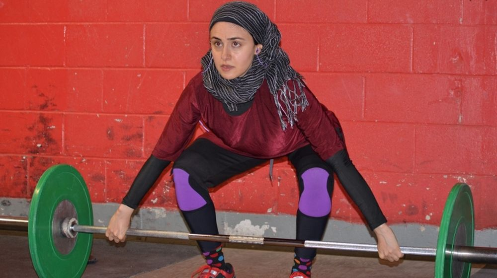 woman weightlifter, Pakistani woman weightlifter, woman PhD student weightlifter, woman weightlifter in Pakistan,
